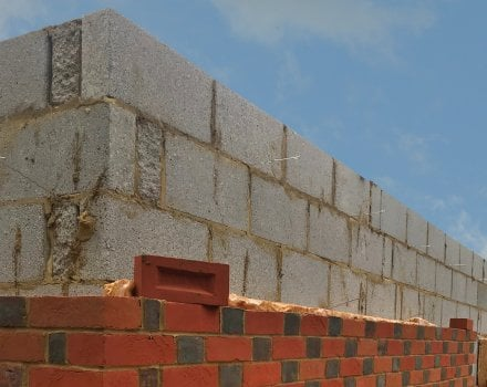 Can you use imperial size bricks with metric blocks when building a new cavity wall?