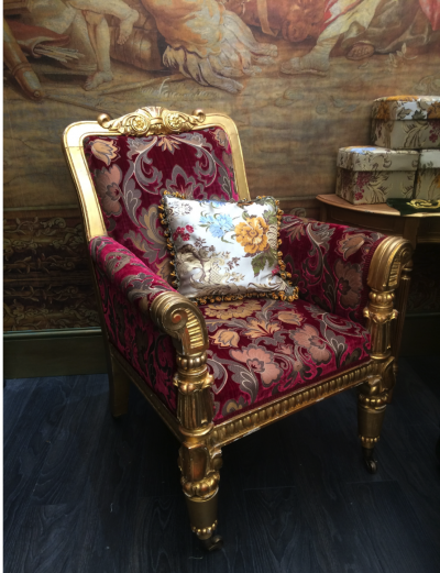 Ornate gold chair with wine coloured fabric