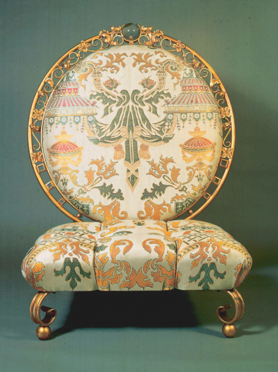 gold chair with green and beige fabric