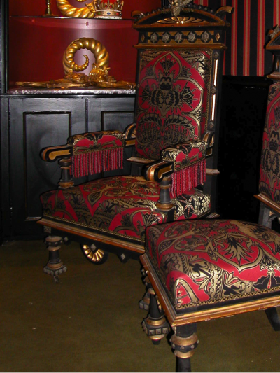 thrones with gold black and red fabric