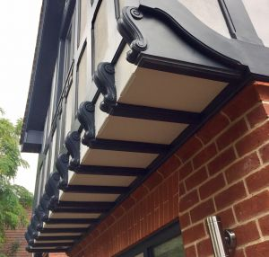 exterior woodwork with corbels