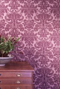 Magenta damask wallpaper in study