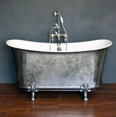 Cast iron bath with roll top edges