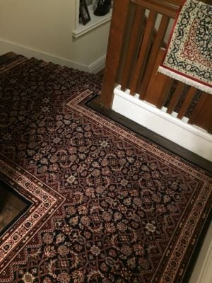 Patterned stair runner carpet on landing