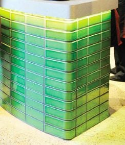 Green glazed brick island