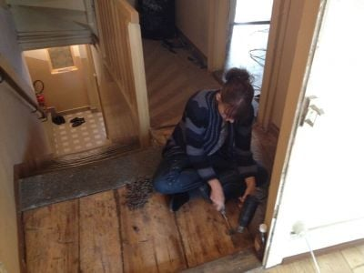 stripping floor boards in victorian house renovation