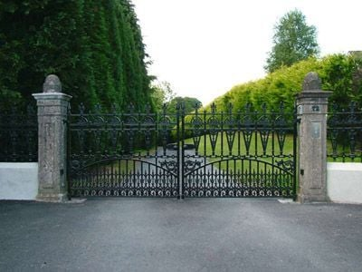 Winchester driveway gate with stone piers