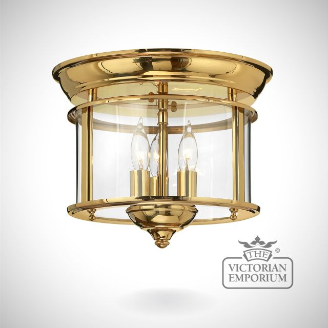 Gentry flush mount light in polished brass