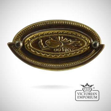 Stamped brass oval plate handle with Lyre design