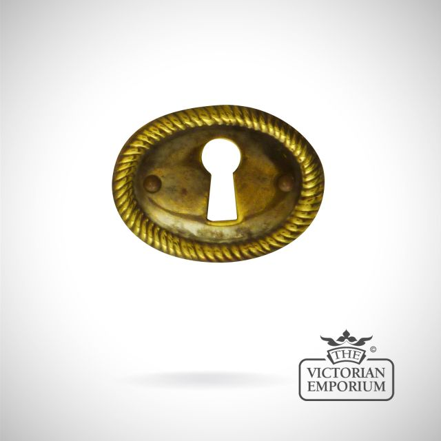 Stamped brass oval rope twist escutcheon