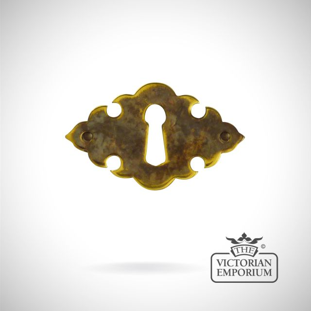 Stamped brass leaf design escutcheon
