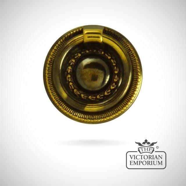 Ornate ring handle