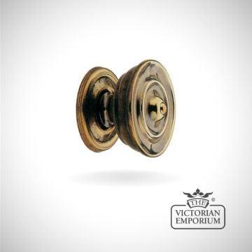Plain cupboard knob in antique brass