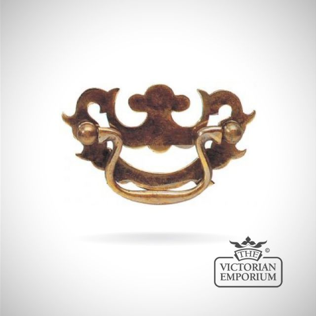 Traditional solid brass fretted plate handle with smiling plate design