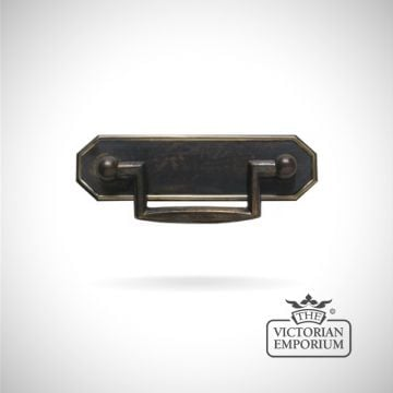 A solid brass hexagonal design plate handle with a forged brass grip