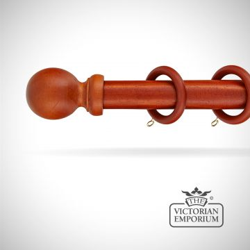 Louth wooden curtain pole set in walnut in a choice of 6 lengths