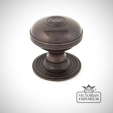 Pressbury centre door knob in Aged Bronze