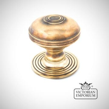 Pressbury centre door knob in Aged Brass