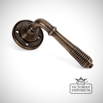 Reeded Lever Handle on Rose in Aged Bronze