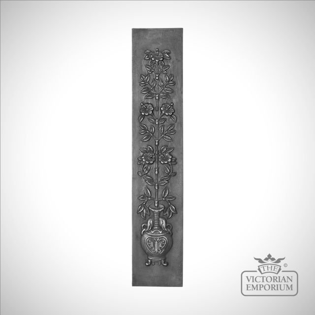 Cast fireplace panel featuring leaves and flowers in an urn