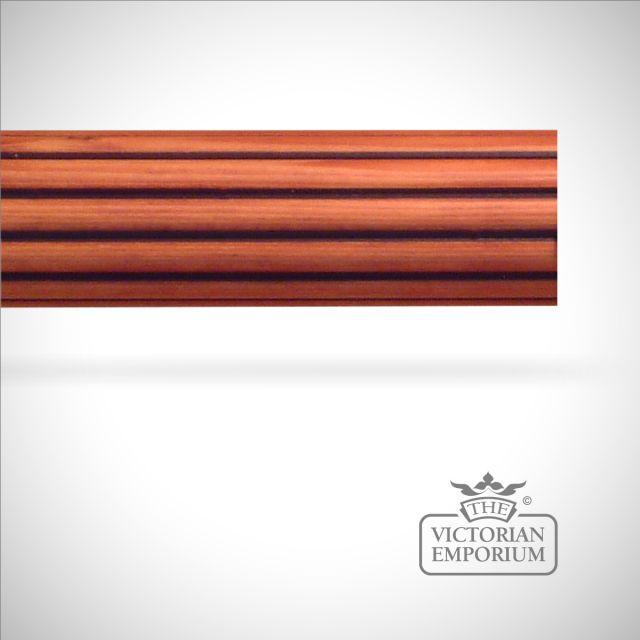 Reeded curtain pole with stained wood and then embellished by hand