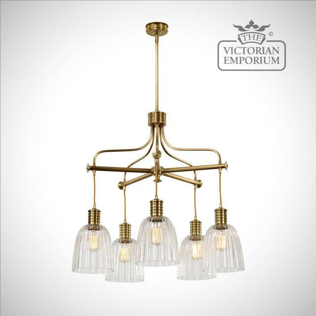 Douillet 5 arm chandelier in Aged Brass