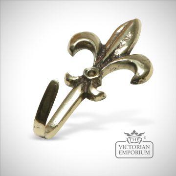 Fleur de lys hook in cast brass