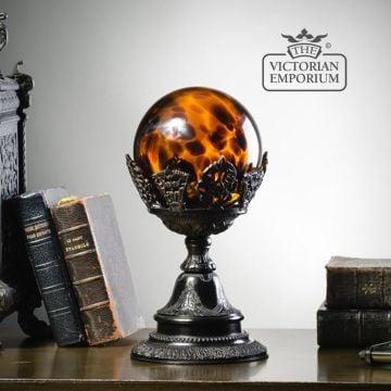 Leopard glass bowl on black brass stand