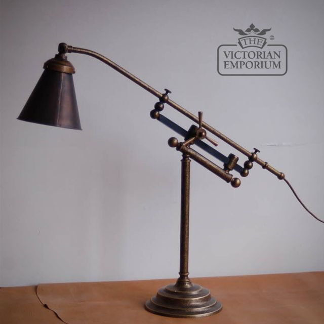 Adjustable brass desk lamp with copper shade