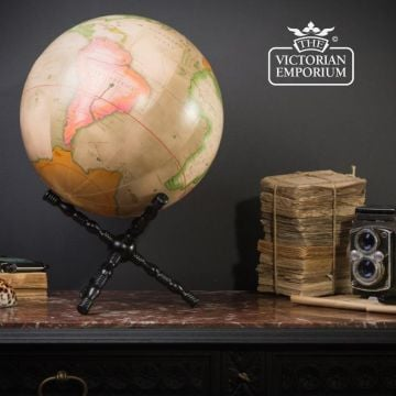 Pink earth globe on cross stand