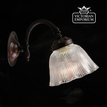 Reeded and fluted glass wall sconce in antique bronze