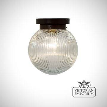 Reeded glass globe flush mount ceiling light with antique bronze metalwork