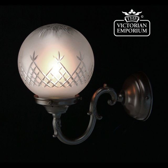 Pineapple cut glass wall light with antique bronze metalwork