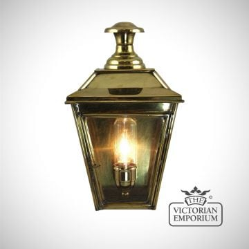 William half wall light in distressed brass