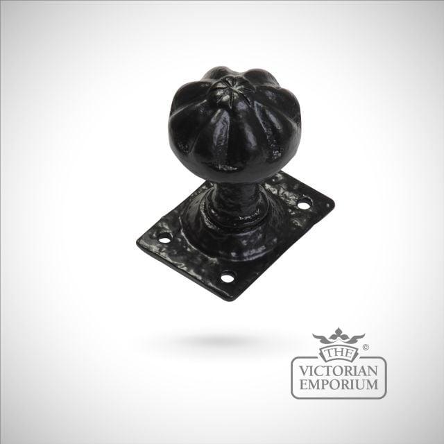 Black iron handcrafted door knob on rectangular plate