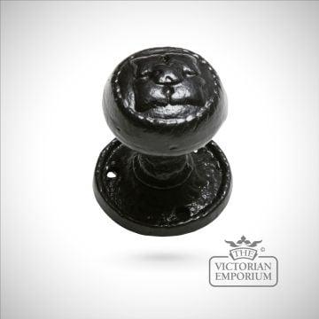 Black iron handcrafted door knob on circular plate