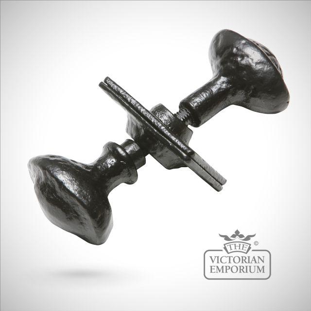 Black iron handcrafted round door knob on rectangular plate