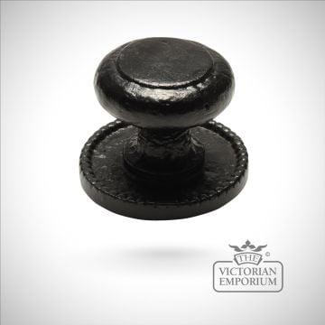 Black iron handcrafted centre door knob on round plate