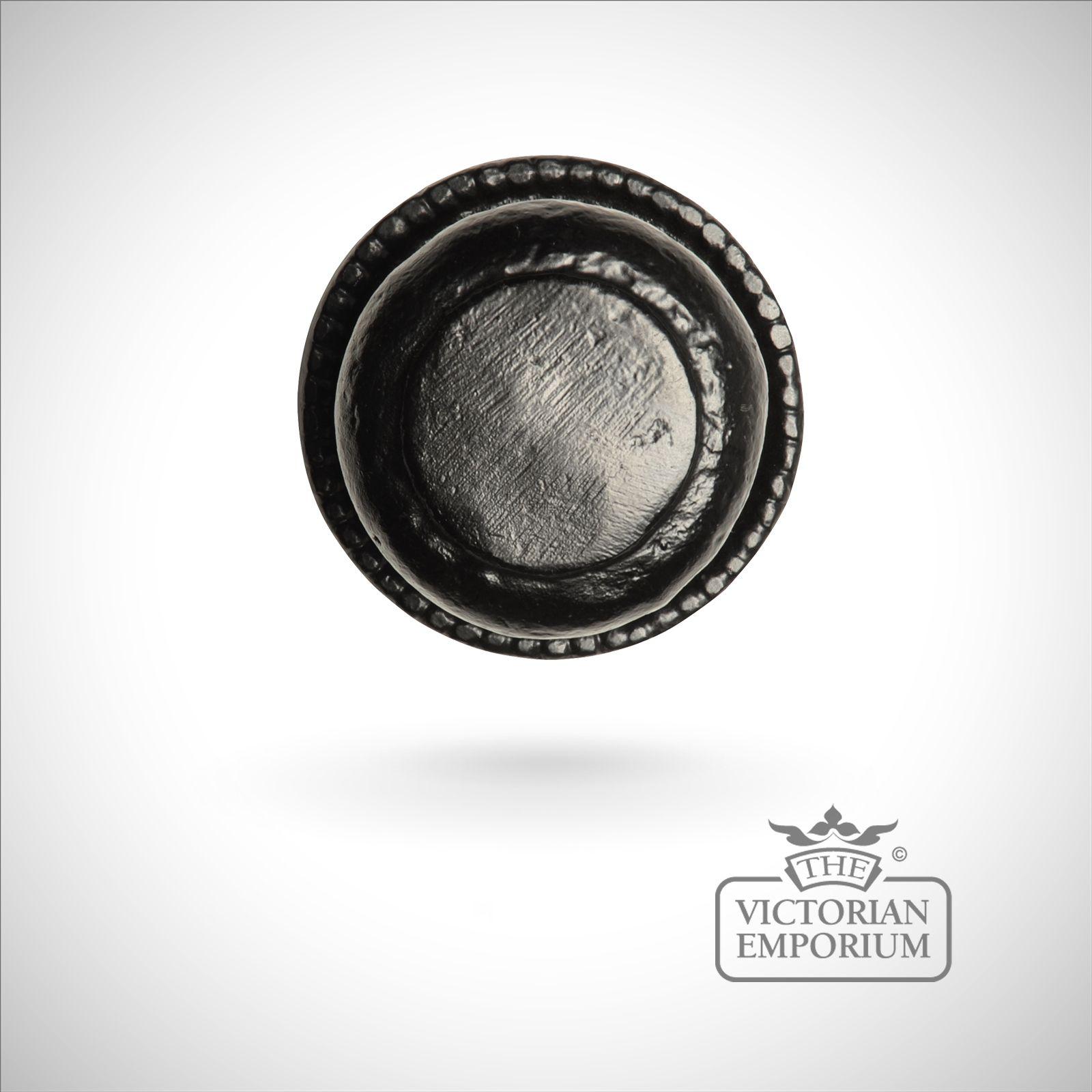 iron handcrafted centre door knob on round plate
