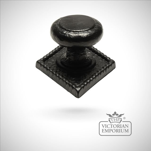 Black iron handcrafted centre door knob on rectangular plate