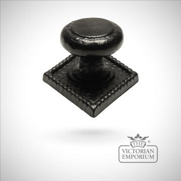 Black iron handcrafted centre door knob on rectangular plate