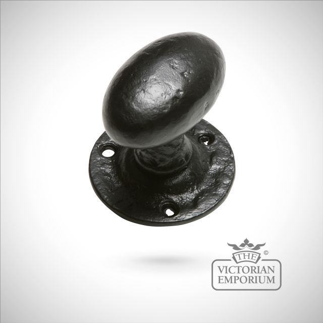 Black iron handcrafted oval door knob on round plate