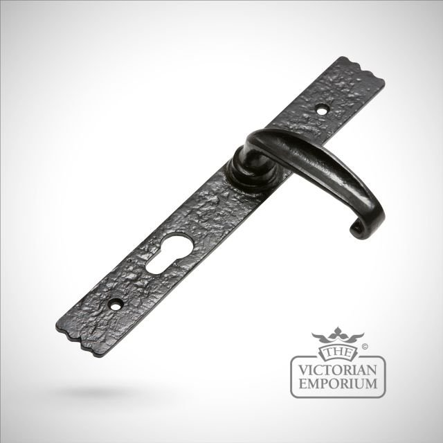 Black iron handcrafted door handle on plain rectangular plate