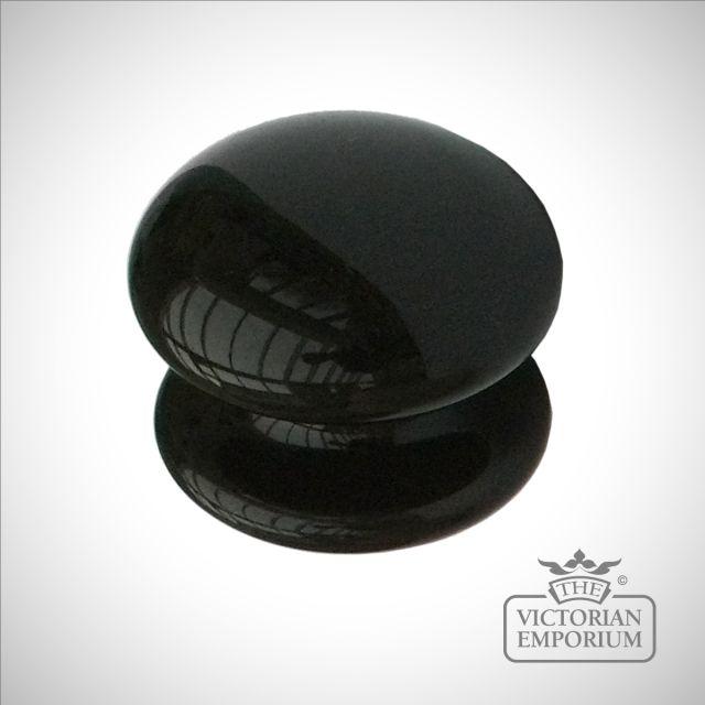 Round black or cream cabinet knob