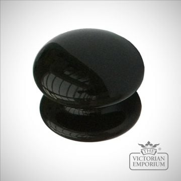 Round black or cream cabinet knob