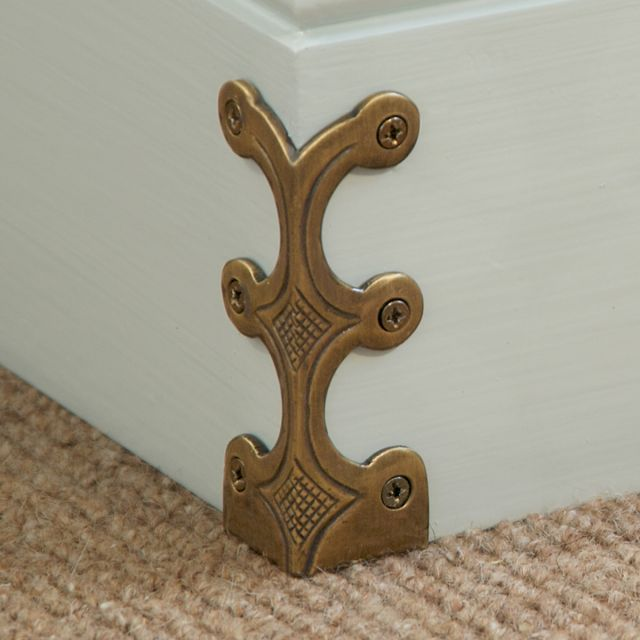 Solid brass skirting board corner protectors