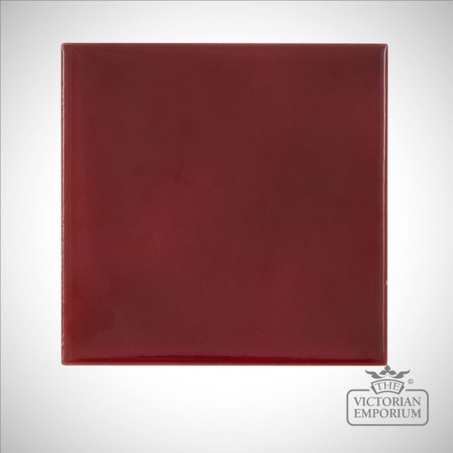 Deep red square fireplace tiles