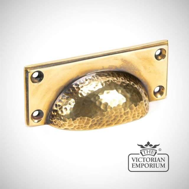 Hammered pull handle in aged brass