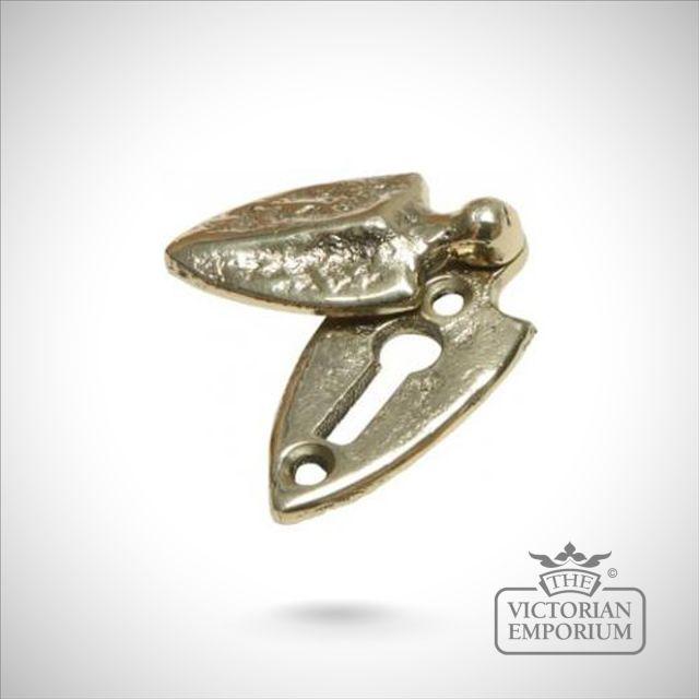 Solid cast brass shield covered escutcheon